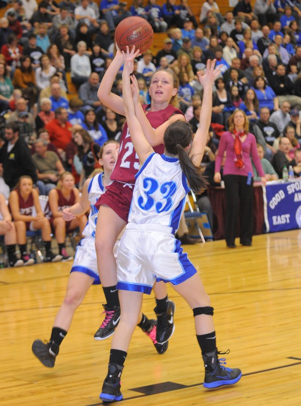 Mattanawcook Academy's Katie Karpf goes up for a shot over Stearns High School's Alexandria Mooney during the second half of the girls Class C quarterfinal game at the Bangor Auditorium Tuesday afternoon.