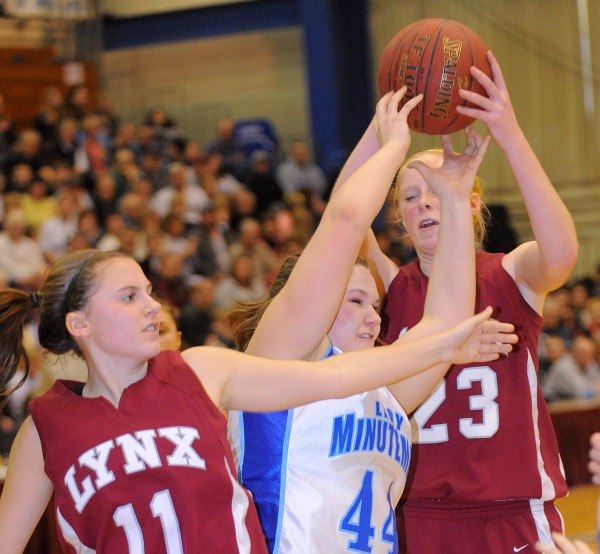Stearns High School's Lilly Dow (center) battles for a rebound with Mattanawcook Academy's Harli Maxwell (left) and Taylor Hawkins during the second half of the girls Class C quarterfinal game at the Bangor Auditorium Tuesday afternoon.