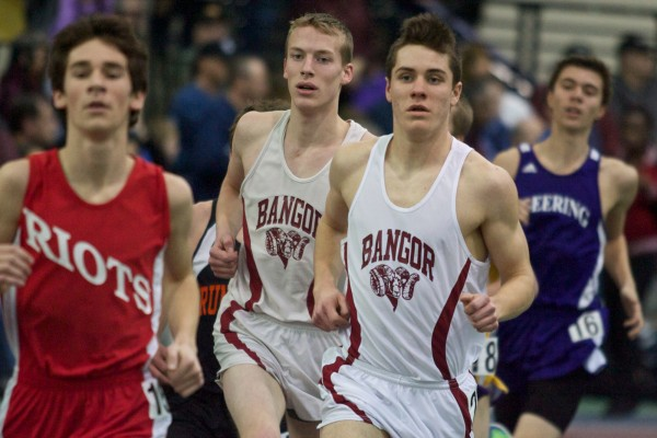 Bangor High School runners Jon Belanger (left) and Jon Stanhope compete in the two-mile run at the Maine Class A Indoor Track State Meet in Gorham, Monday Feb. 20, 2012.