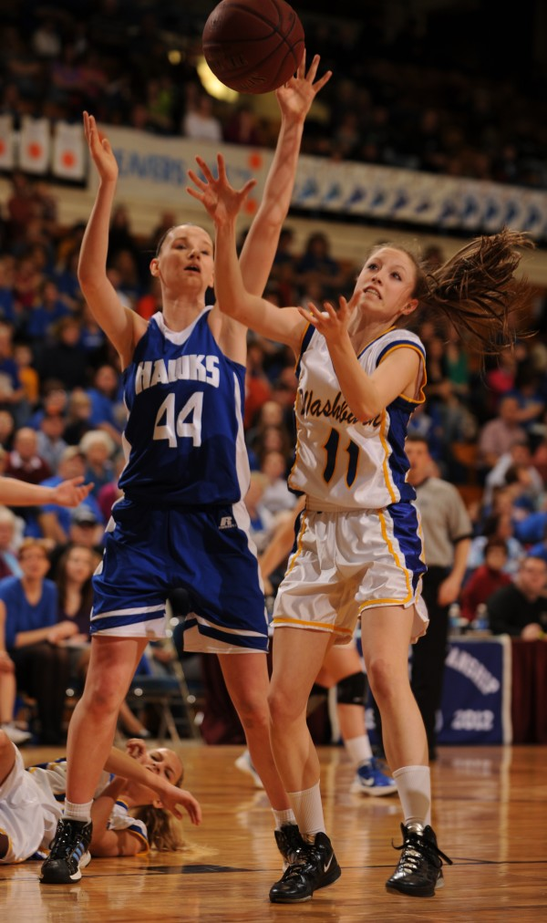 Hodgdon's Jennah Steamer and Washburn's Joan Overman vie for possesion of a rebound during class D Eastern Maine final action at the Bangor Auditorium on Saturday, Feb. 25, 2012.