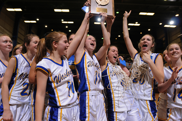 Washburn girls basketball team celebrates with their Eastem Maine Class D trophy at the Bangor Auditorium on Saturday, Feb. 25, 2012.