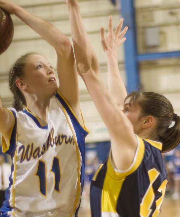 Washburn High School girls basketball player Carsyn Koch (11) drives to the hoop over Van Buren girls player Ashley Wilson (21) in the first half of their Class D semi-final game in Bangor, Maine, Thursday, Feb. 23, 2012.