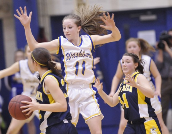 Washburn High School girls basketball player Carsyn Koch (11) gets in the face of Van Buren girls player Parise Rossignol (22) in the first half of their Class D semi-final game in Bangor, Maine, Thursday, Feb. 23, 2012.