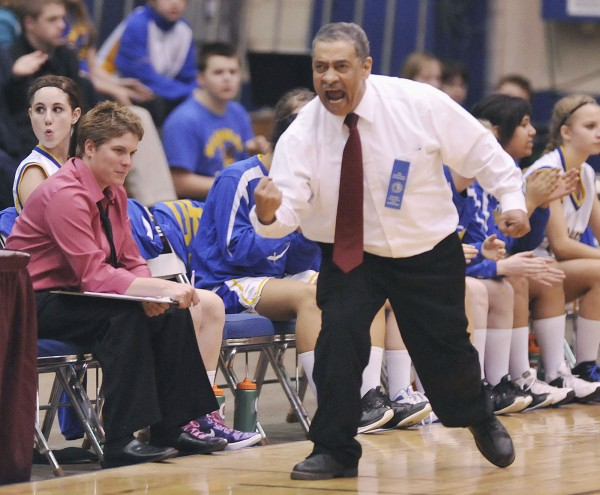 Washburn High School girls basketball Mike Carlos gets enthusiastic about his team's performance against the Van Buren girls in the first half of their Class D semifinal game in Bangor, Maine, Thursday, Feb. 23, 2012.