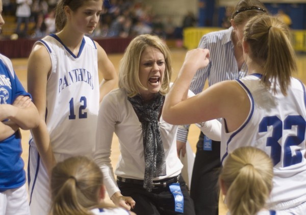 Central Aroostook High School girls basketball coach Stori Shaw encourages her team after falling behind Hodgdon in the first half of their Class D playoff game in Bangor, Maine, Thursday, Feb. 23, 2012.