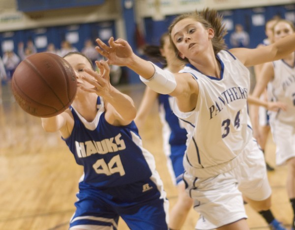Central Aroostook High School girls basketball player Victoria McIntyre (34) and Hodgdon player Jenna Steamer (44) reach for a loose ball in the first half of their Class D playoff game in Bangor, Maine, Thursday, Feb. 23, 2012.