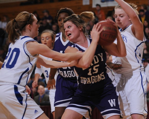 Woodland's Taylor Cochran (center) fends off Central Aroostook's Sarah Grass (left) and Kayla Cushman (right) while rebounding during Class D quarterfinal action on Monday, Feb. 20, 2012, at the Bangor Auditorium. Central Aroostook won 34-29.