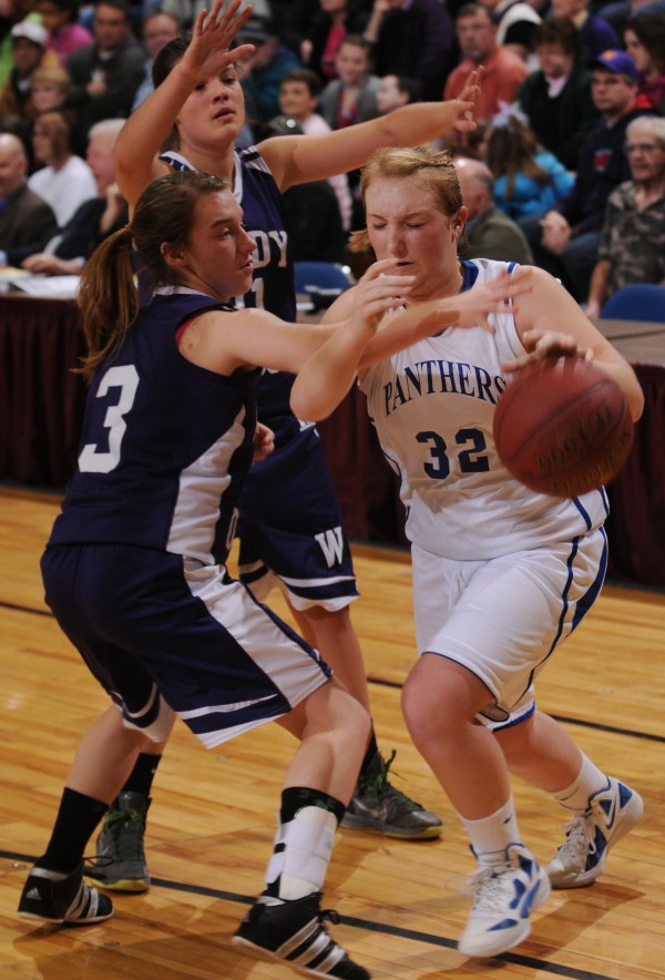Cental Aroostook's Rachael Grew attempts to dribble past Woodland defender Mallory P. Roderick during Class D quarter final action on Monday, Feb. 20, 2012, at the Bangor Auditorium. Central Aroostook won 34-29. Behind them is Woodland's Araceli Garcia (11).
