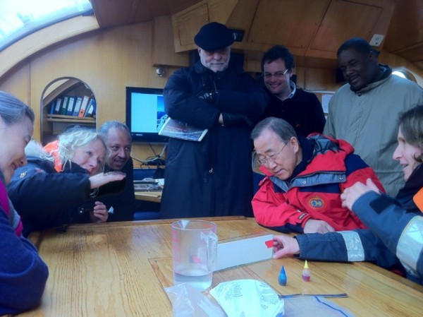University of Maine marine science professor Lee Karp-Boss (sitting, right) explains part of the scientific research behind the 2 1/2-year Tara Oceans Expedition to United Nations Secretary General Ban Ki-moon (sitting, second from right) and his wife, Yoo (Ban) Soon-taek (sitting, left). Sitting next to the secretary general's wife is French fashion designer Agnes B., the owner of the Tara and a financial contributor to its research.