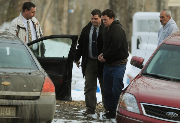 Daniel Porter (second from right) is led to a waiting police car by Maine State Police detective Brian Strout (second from left) as Bangor Police detective Larry Morrill holds the door. Porter was arrested at his father's home in Jackson and is being charged with murder in connection with the disappearance of Florida firefighter Jerry Perdomo. Porter's father Gary (right) was present when his son was arrested.