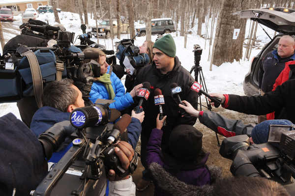 Chris Lerch (center) is mobbed by media on Tuesday, Feb. 28, 2012, moments after he watched Maine State Police and Bangor Police take Daniel Porter away in handcuffs for the murder of missing Florida firefighter Jerry Perdomo. Lerch is married to Perdomo's sister.