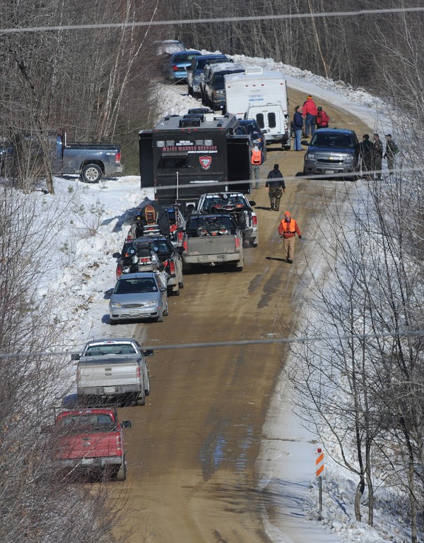 Maine State Police cars and game warden trucks line the side of Dahlia Farm Road in Newburgh during the search for the body of Jerry Perdomo.