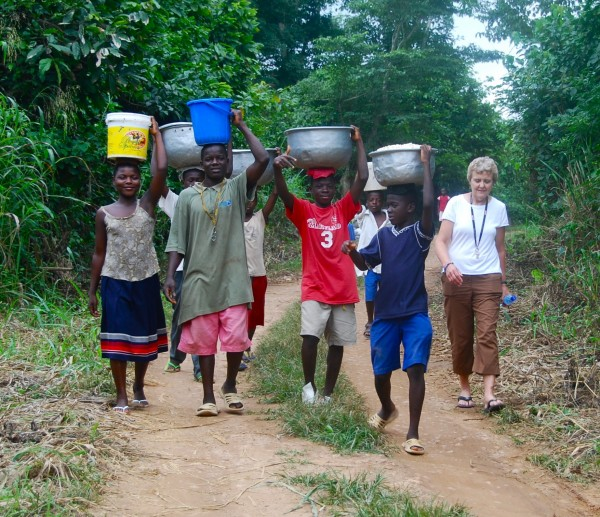 A group of kids from the Baptist Orphanage and School Complex are taking the corn they grew to the corn mill in the village crossroads in August 2011. Pictured are Patience (left to right), Emmanuel, Michael, Jacob (behind) and Samuel with Betty Jamison, a sixth-grade teacher at Bangor's William S. Cohen School.