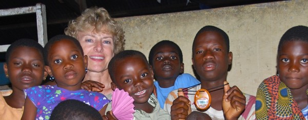 Dorcas (left to right), Sylvia, Anita, Phillip, Stephen and Gertrude with Kristine Reid, a teacher at Bangor's William S. Cohen School, are sitting in the center pavilion at the Baptist Orphanage and School Complex in Ghana in August 2011.