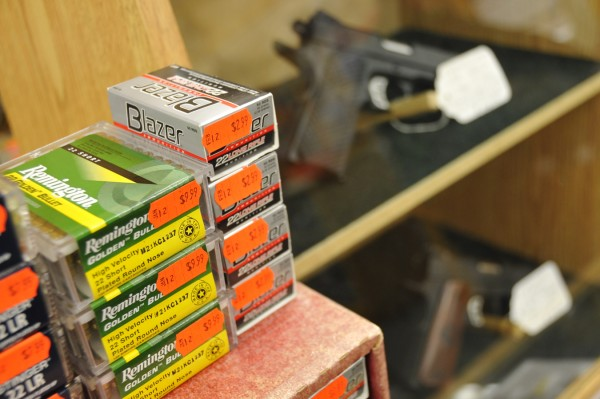 Firearm cartridges sit atop a display case of handguns at Van Raymond Outfitters in Brewer on Wednesday, Feb. 22, 2012.