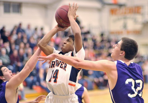 Brewer boy's basketball player Mike Ogbonna (14) splits the defense of Hampden players Matthew Martin, left, and Logan Poirier (32) to get off a shot in the first half of their game in Brewer, Maine, on Friday, Feb. 3, 2012.