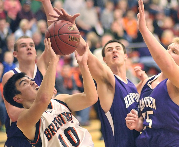 Brewer boy's basketball player Yuhi Sasaki (10) gets nowhere as he tries the baseline by Hampden defenders Matthew Martin, back, and Frederick Knight (55) in the first half of their game in Brewer, Maine, on Friday, Feb. 3, 2012.