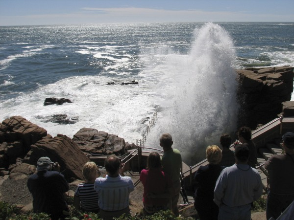 Tourists admire spray from waves crashing into Thunder Hole in Acadia National Park in August 2011.
