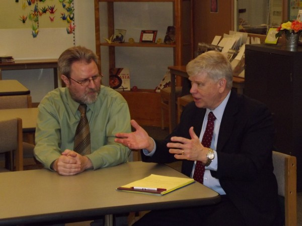 Senior Advisor to the Secretary of the U.S. Department of Education Jo Anderson Jr. speaks to MSAD Superintendent Ken Coville during a press conference at Carrabec High School in North Anson on Wednesday, Feb. 1, 2012.
