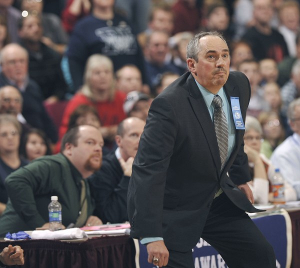 Camden Hills boys basketball coach Jeff Hart watches the shot at the buzzer as the MDI boys prevail jn a Class B basketball game at the Bangor Auditorium on Saturday.