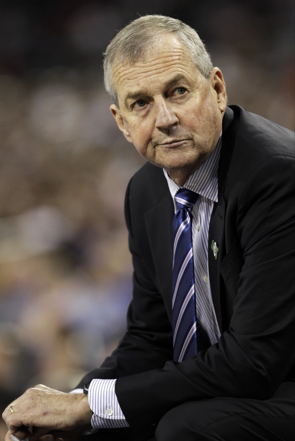 In this April 4, 2011 file photo, Connecticut head coach Jim Calhoun sits on the sideline during the second half of the men's NCAA Final Four college basketball championship game against Butler, in Houston.