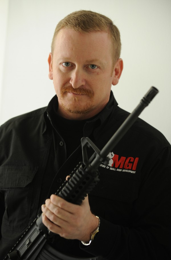 Mack Gwinn, president of MGI, holds one of the small arms that his company manufactures at the its Old Town facility on Tuesday, Feb. 14, 2012.
