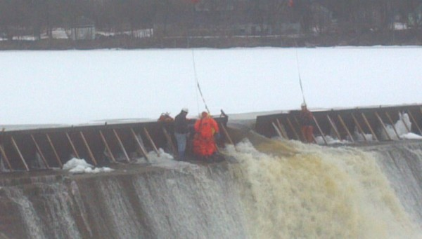 Rescue workers from Milford, Old Town and Orono fire departments helped free a pinned dam employee on Wednesday, Feb. 22, 2012.