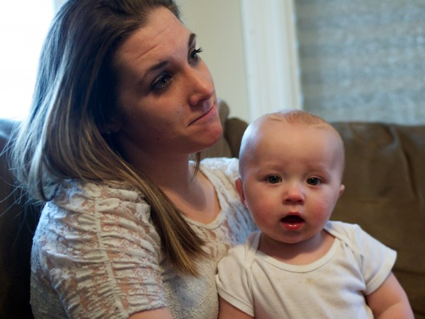 Trista Reynolds holds son Raymond Fortier while talking about her missing daughter Ayla Reynolds in Portland on Feb. 15, 2012. Ayla went missing from her father's home in Waterville in December.