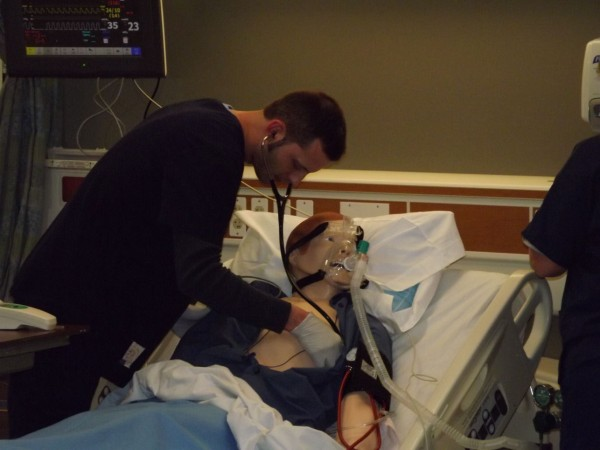 Respiratory therapy student Rick Lewis tends to an interactive mannequin during a simulation of Kennebec Valley Community College's new health care simulation laboratory in Fairfield on Tuesday, Feb. 14, 2012.