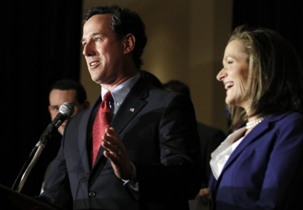 Republican presidential candidate former Pennsylvania Sen. Rick Santorum speaks next to his wife Karen, right, during a primary night watch party Tuesday, Feb. 7 in St. Charles, Mo.