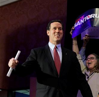Republican presidential candidate, former Pennsylvania Sen. Rick Santorum arrives for his primary election night party, Tuesday, Feb. 28, in Grand Rapids, Mich.