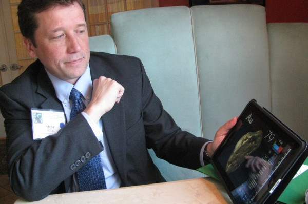 Stephen Bowen, the commissioner of the Maine Department of Education, displays an iPad science app during a break in June 2011 at the 100th annual School Superintendents and Assistant Superintendents Conference in Augusta. &quotWe've got to transform,&quot he said about public education.