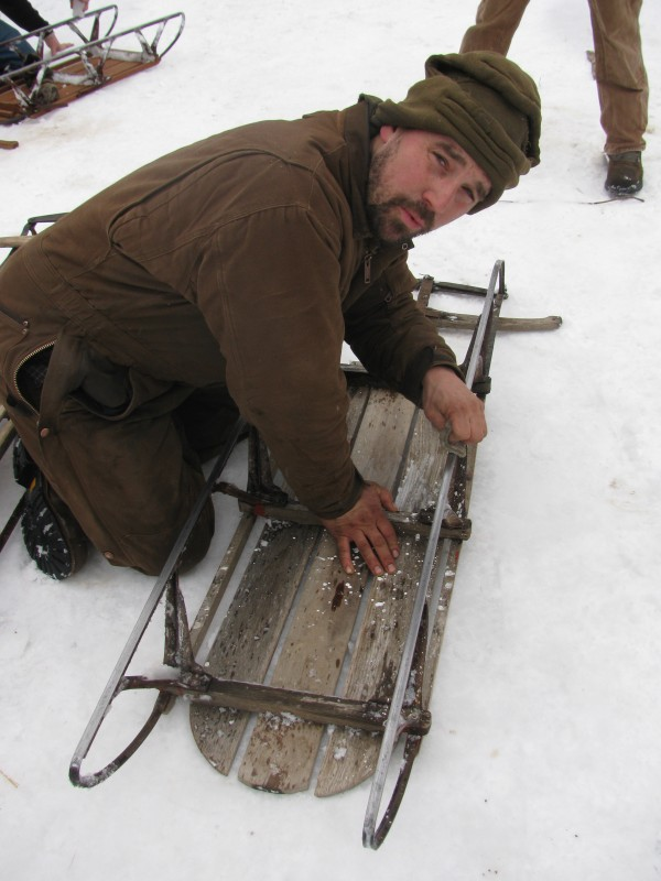 G.W. Martin of Montville readies his runner sled Saturday afternoon for another race down Hogback Mountain. The organizer of the annual event ultimately came in second.