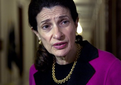 Sen. Olympia Snowe, R-Maine, speaks to media outside her office on Capitol Hill in Washington, Tuesday night, Feb. 28, 2012, about her decision not to run for re-election.