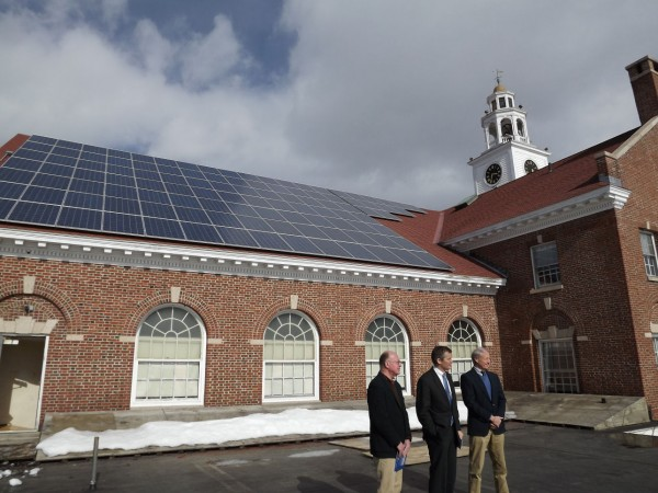 Glenn Cummings (center), president and executive director of Good Will-Hinckley and the Maine Academy of Natural Sciences, shows off 110 solar panels installed on the roof of Prescott Hall in Hinckley on Monday, Feb. 13, 2012. Steve Cole (left), director of sustainable communities for Coastal Enterprises, and Bill Behrens (right), co-founder of ReVision Energy, also pose for cameras.