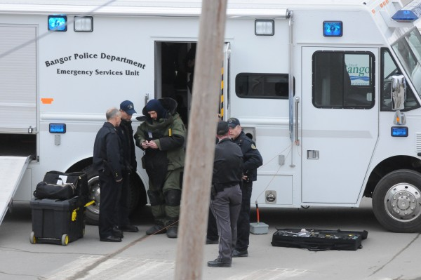 Members of the Bangor Police Department confer after taking an initial look at a suspicious package at the Margaret Chase Smith Federal building in Bangor on Friday, Feb. 24, 2012.