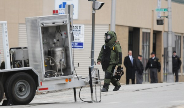 A member of the Bangor bomb squad walks toward the entrance of the Margaret Chase Smith Federal building in Bangor on Friday, Feb. 24, 2012 to investigate the reports of a supicious package.