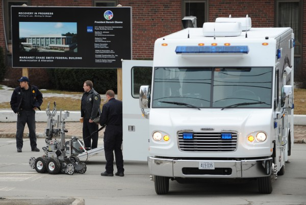 Members of the Bangor Police Department ready a remote control robot to be used in the recovery of a suspicious package at the Margaret Chase Smith Federal Building in Bangor on Friday, Feb. 24, 2012.