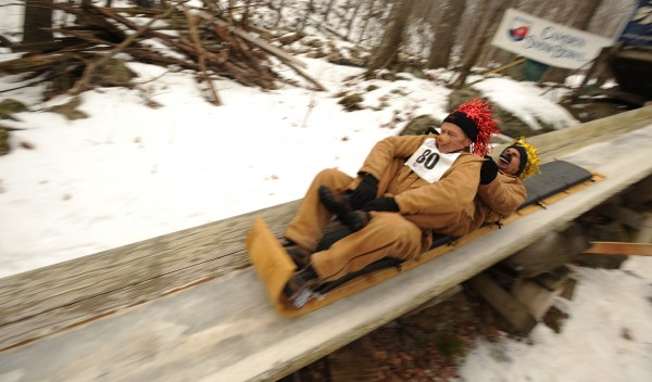 A two-man toboggan team, The In-Laws, made up of Rick Pierson of Northport and Mark Castlellano of Rockland, take to the toboggan chute at the Camden Snow Bowl on Saturday, Feb. 11, 2012 for the 22nd annual U.S. National Toboggan Championships.