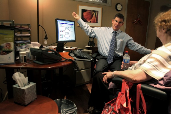 Dr. Greg Plotnikoff talks with patient Bernice Koniar at his office in Minneapolis, Minnesota, in September 2010. Plotnikoff touts the health benefits of Vitamin D for treatment of some conditions.