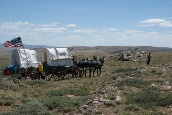 Nick and Rinker Buck lead their mules across a rocky part of the Oregon Trail.