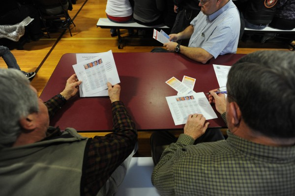 Registered Republican voters Elton Anderson, left, and Gary Willey, both of Milbridge, review presidential comparison materials before the Washington County Republican Super Caucus on Saturday.