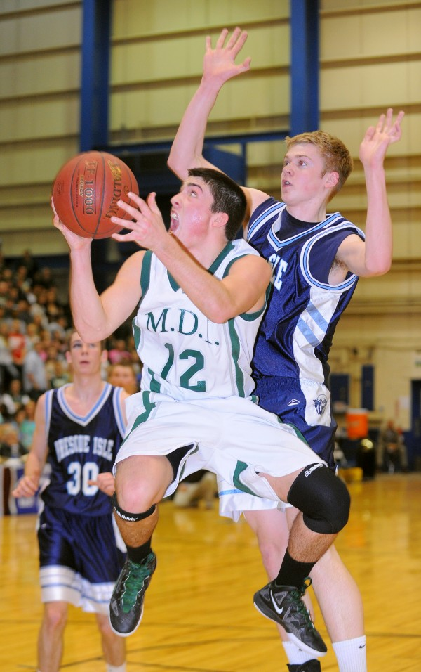 MDI High School's Nick Shaw drives for the basket past Presque Isle High School's Tyler Brooks during the first half of the Class B semifinal game at the Bangor Auditorium on Wednesday, Feb. 22, 2012.