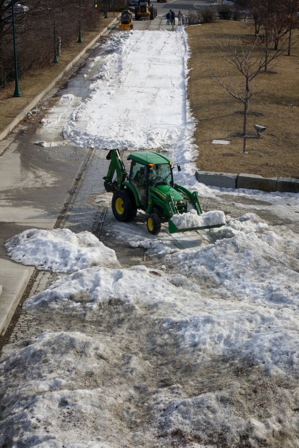 A tractor spreads snow at Thomas Knight Park in South Portland Thursday February 16, 2012 in preparation for Winter Festival activities including a &quothuman dogsled race&quot on Saturday.