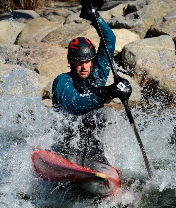 Salida, Colo., resident Matt Fritz rides through the whitewater park on the Arkansas Rvier in town on Jan. 25, 2012. Fritz and other residents kayak the river all winter long.