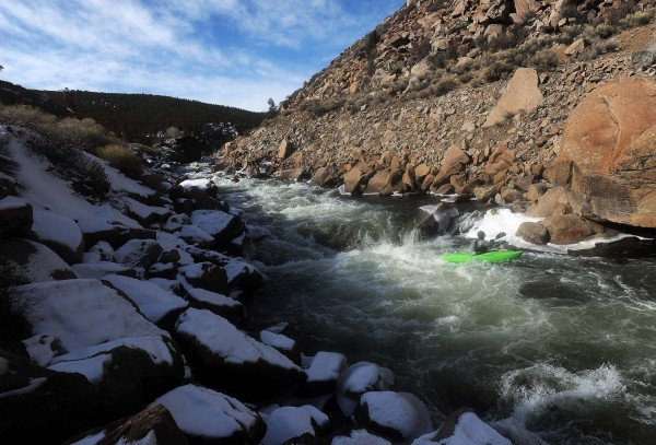Kayakers paddle the cold waters of the Arkansas River north of Buena Vista, Colo., on Jan. 25, 2012. Most of the paddlers said they draw the line when the water dips below 27 degrees.