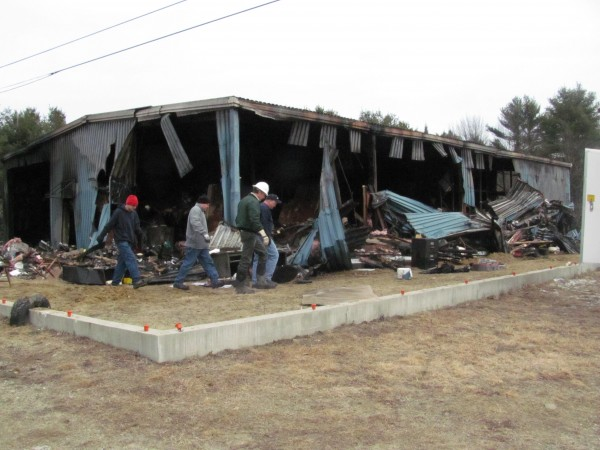 Employees of Twin City Lock & Key survey the devastating damage to the business's headquarters on Chewonki Neck Road in Wiscasset on Monday, Feb. 27, 2012.