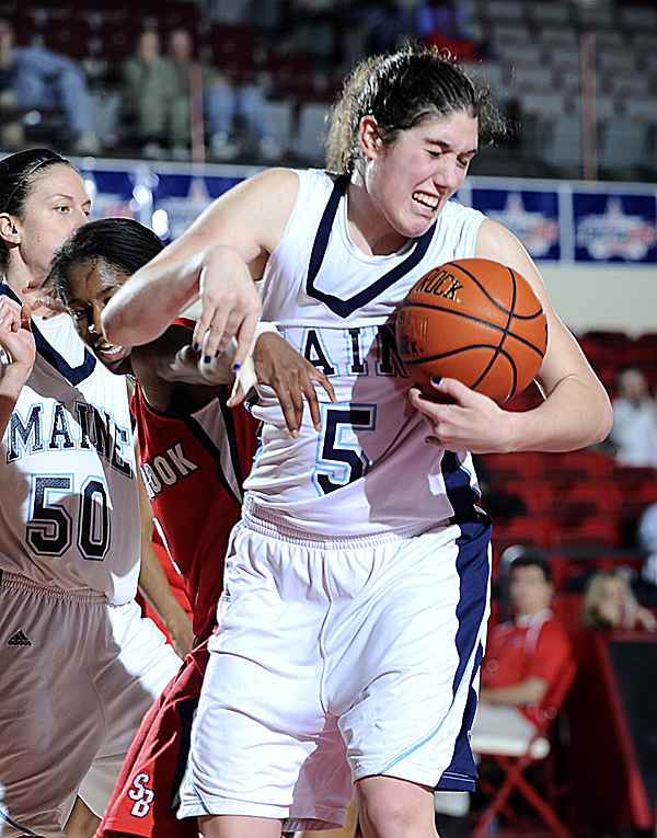 Maine's Danielle Walczak pulls a rebound away from a Stony Brook player during their America East tourney first-round game Thursday night in West Hartford, Conn. Walczak scored 10 points and had eight rebounds to help Maine win 49-43.