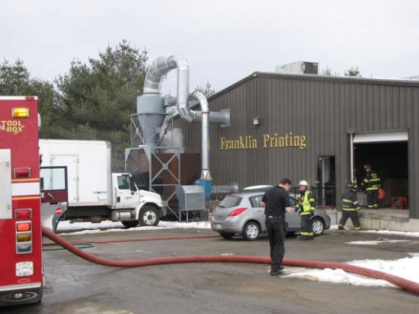 Firefighters find smoke pouring from the top of a trash compactor on the west side of Franklin Printng when they were called to the Wilton Road printing firm about noon on Sunday, March 4, 2012 in Farmington.