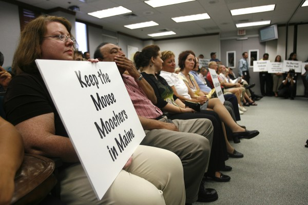 Judy Burris, an employee from Arthrex, holds a sign to show her disapproval of Jackson Labs potential move to Naples in June 2010.
